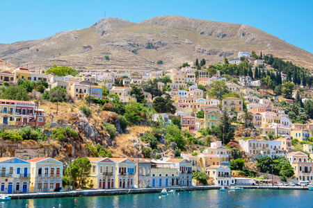 waterfront: Gialos Harbour. Symi, Dodecanese Islands. Greece, Europe Stock Photo