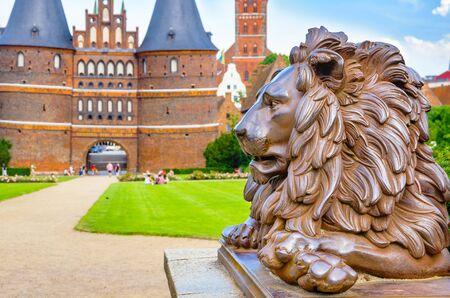 schleswig holstein: Lion statue beside Holstein Gate at Lubeck. Schleswig Holstein, Germany Stock Photo