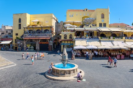 hippocrates: RHODES ISLAND, GREECE - JULY 4: Tourists walking on Hippocrates square in the historic old town of Rhodes, Greece on July 4, 2015. Rhodes is an island in Greece, located in the eastern Aegean Sea