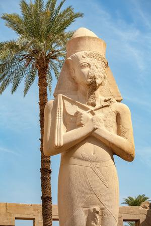 thebes: Statue of Pharaoh Ramses II in Temple of Karnak. Luxor, Egypt