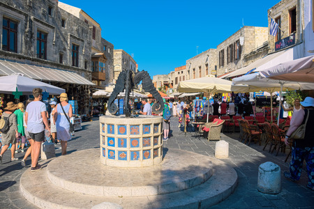 jewish town: RHODES ISLAND, GREECE - JULY 4: Tourists visiting and shopping at square of the Jewish Martyrs in the historic old town of Rhodes, Greece on July 4, 2015. Rhodes is an island in Greece, located in the eastern Aegean Sea