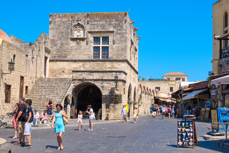 hippocrates: RHODES, GREECE - JULY 4, 2015: Tourists visiting and shopping at square of the Hippocrates in the historic old town of Rhodes Editorial