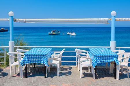 skala: Sidewalk cafe in the village of Kamiros Skala. Rhodes, Greece