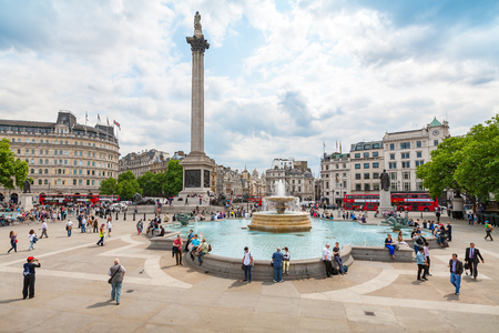 admiral: LONDON, ENGLAND - JUNE 26, 2013: Tourists and Londoners enjoy a summers day around the fountains of Trafalgar Square