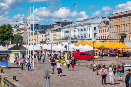 HELSINKI, FINLAND - JULY 19, 2016: Tourists visiting and shopping at Market Square near Helsinki Northern Harbour Editorial