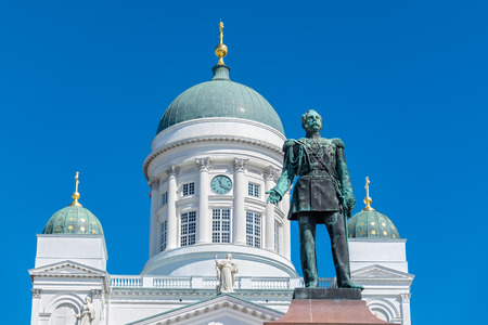 senate: Statue of Russian Emperor Alexander II and Lutheran Cathedral on the Senate Square. Helsinki, Finland, Scandinavia Stock Photo