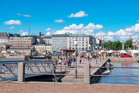 kauppatori: HELSINKI, FINLAND - JULY 19, 2016: Tourists visiting and shopping at Market Square near Helsinki Northern Harbour Editorial