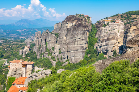 Rock formations of the Meteora with Monastery of Roussanou, St. Nicholas Anapausas, Great Meteora and Varlaam. Meteora, Plain of Thessaly, Greece, Europe