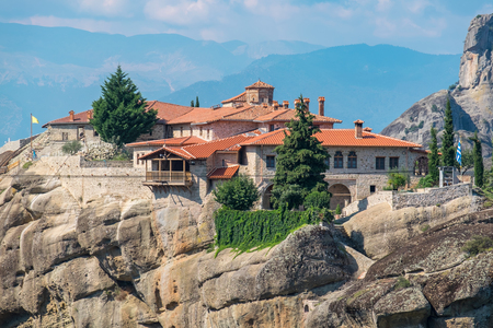 thessaly: Rock formations of the Meteora with Monastery of  Holy Trinity (Agia Triada). Meteora, Plain of Thessaly, Greece, Europe