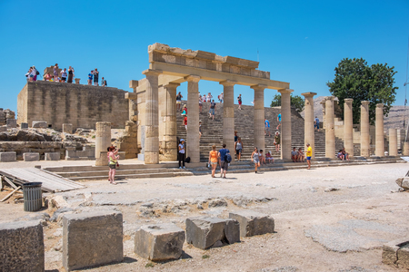 LINDOS, RHODES ISLAND, GREECE - JULY 9, 2015: Tourists visiting in the Acropolis of Lindos. In the center Staircase of the Propylaea Editorial