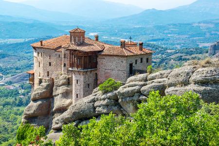 thessaly: View of the Meteora with Monastery of Roussanou (Agias Varvaras). Meteora, Thessaly, Greece, Europe  Stock Photo