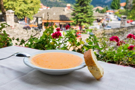 Dish of Fasolada (traditional Greek white beans soup) and bread. Metsovo, Epirus, Greece,
