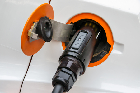 plug in: Charging cable with a plug in socket of a electric car