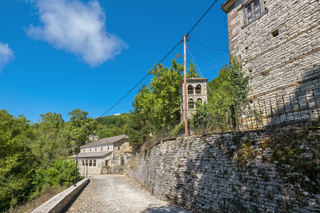 Stone road and houses in Koukouli, one of the stone villages of Zagoria. Epirus, Greece Stock Photo