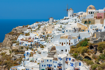 the white house: Houses and windmill in the village of Oía. Santorini island, Cyclades, Greece, Europe Stock Photo