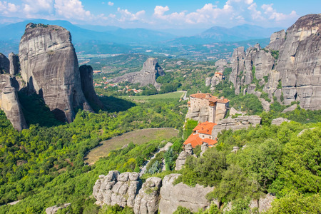 View of rock formations of the Meteora with Monastery of Roussanou and St. Nicholas Anapausa. Meteora, Plain of Thessaly, Greece, Europe