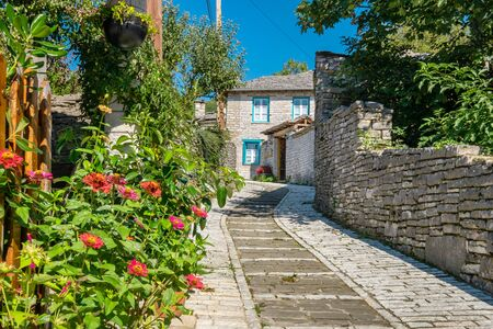 Stone walkway and house in Monodendri, one of the stone villages of Zagoria, Epirus, Greece Stock Photo
