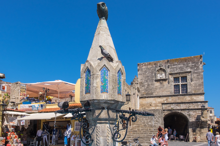 hippocrates: RHODES, GREECE - JULY 4, 2015: Sintrivani Fountain on Hippocrates Square in the historic old town