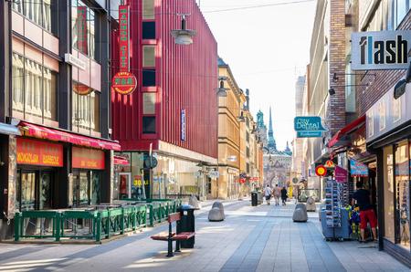 stone lion: STOCKHOLM, SWEDEN - JUNE 04, 2011: Drottninggatan (Queen Street) is a major pedestrian street in city Editorial