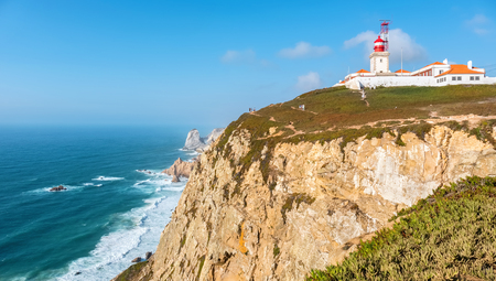 Lighthouse and cliffs over Atlantic Ocean. Cabo da Roca, Portugal