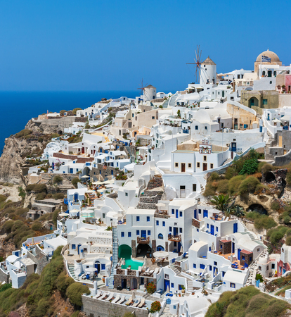 Houses and windmill in the village of Oia. Santorini island, Cyclades, Greece, Europe