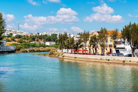 TAVIRA, PORTUGAL - AUGUST 30, 2017: A view of the historic town along the Gilao river at the east Algarve Editorial
