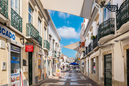 FARO, PORTUGAL - AUGUST 30, 2017: Shops and street cafe on a pedestrian area in old town Editorial