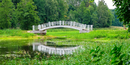 White wooden bridge in old park. Alatskivi, Estonia, Europe Stock Photo