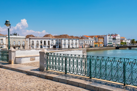 View on historic town of Tavira from Roman bridge over River Gilao. Algarve, Portugal Stock Photo