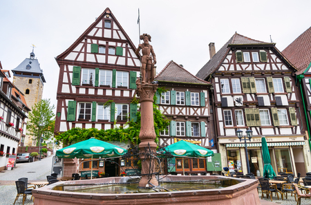 BRETTEN, GERMANY - JUNE 13, 2011: View of fountain and half-timbered houses around a marketplace in old town Editorial