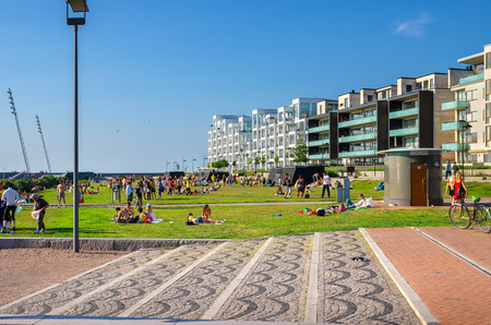 MALMO, SWEDEN - JUNE 05, 2011: People relaxing and sunbathe in the Western Harbour (Vastra Hamnen) district