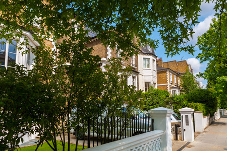 Street with traditional town houses at Hammersmith district in London. England Stock Photo