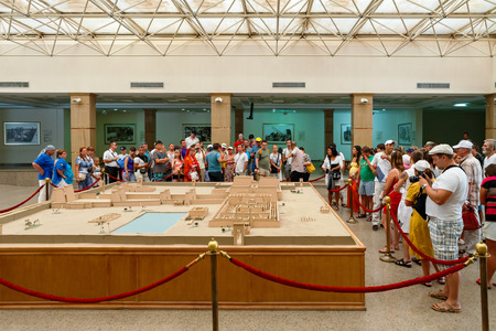 LUXOR, EGYPT - OСTOBER 18, 2012: Tourists guided tour looking at temple complex model in Karnak Temple Visitor Centre