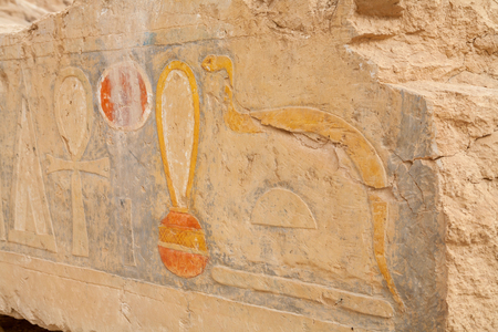 Stone with drawings depicting a snake and the ankh. Mortuary Temple of Hatshepsut, Luxor, Egypt
