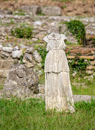 Headless statue in Sanctuary of Demeter at the Archaeological Park of Dion. Pieria, Macedonia, Greece Stock Photo