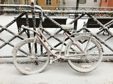 Bicycle covered in snow at old town. Tallinn, Estonia, Europe