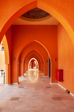 Red arches corridor in building. El Gouna, Egypt, Africa