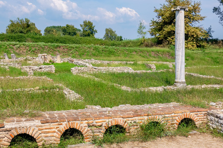 Landscape with column and ancient walls at Dion Archeological Site. Macedonia, Greece