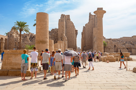 LUXOR, EGYPT - OСTOBER 18, 2012: Tourist group on a guided tour in the Temple of Karnak