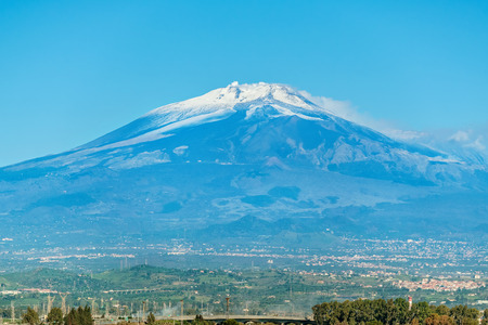 View of the sicilian landscape with smoking Etna volcano. Sicily, Italy Stock Photo