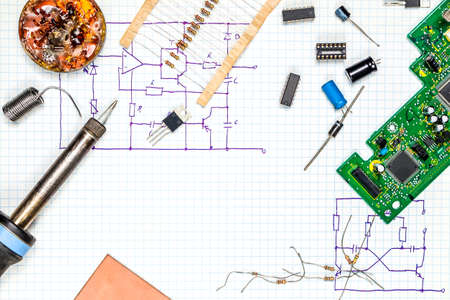 On the desk electronics. Tools and electronic components. Stock Photo