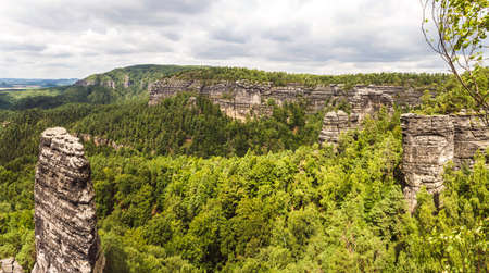 Czech Switzerland - Landscape from the viewpoint. Rocks protruding above the forest. 版權商用圖片