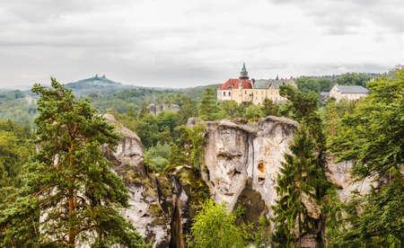 Czech Republic - Hruboskalsko Landscape Park. Landscape with rocks, a forest and a castle on the horizon.
