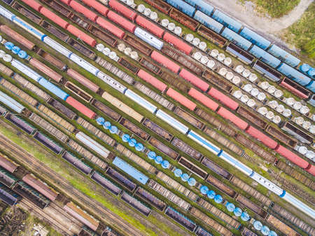 Railway cars lined up in ranks. Colorful wagons seen from the bird's eye view.