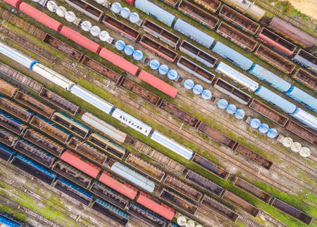 Colorful railway carriages seen from the air. Railway wagons placed in a row on parallel tracks. Standard-Bild