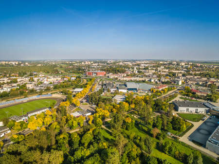 Lublin - the city landscape from the bird's eye view. People's Park, stadium and Aleje Zygmuntowski from the air.