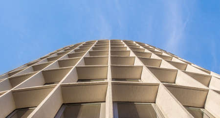 Architectural symmetry against the blue sky. A perspective convergent in urban architecture.