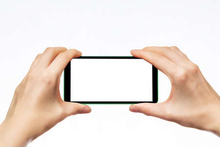Mobile phone kept in both hands. Take photos of a smartphone.