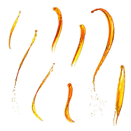 Paints and splashes of liquid on a white background. Yellow-orange liquid isolated from the background.