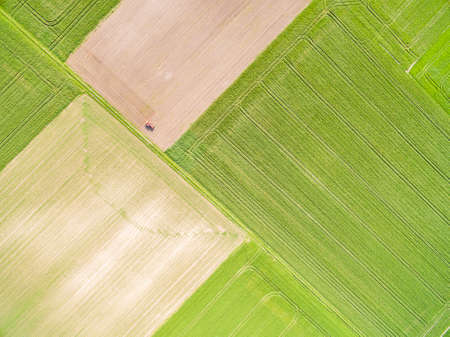 A landscape of farmland seen from the air. Abstract wallpaper - agricultural areas from a bird's eye view.